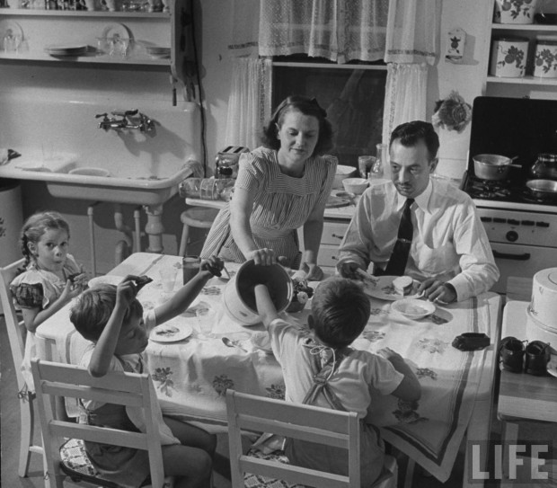 1940s housewife serves lunch